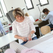 Dressmaker in training class — Stock Photo #35259233