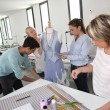 Stock Photo: Students in dressmaking training school
