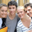 Students standing outside school building — Stock Photo