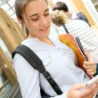 School girl sending message with smartphone — Stock Photo