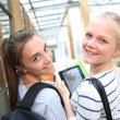 Teenage girls using tablet at school — Stock Photo