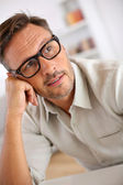 Man with eyeglasses being thoughtful — Stock Photo