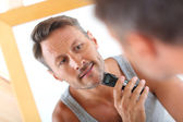 Handsome guy shaving — Stock Photo