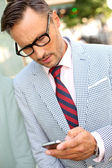 Trendy guy with eyeglasses and tie — Stock Photo