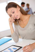 Business girl working on budget — Stock Photo