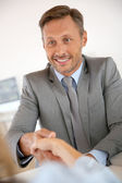 Man shaking hand to job applicant — Stock Photo