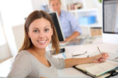 Businesswoman sitting at desk in office — Stock Photo