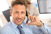 Businessman talking on mobile phone — Stock Photo