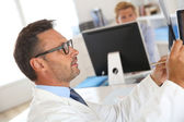 Doctor checking on X-Ray images — Stock Photo