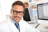 Handsome doctor wearing eyeglasses — Stock Photo
