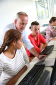 Instructor with students — Stock Photo