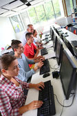 Young people in computing class — Stock Photo