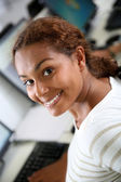Student girl in front of desktop — Stock Photo