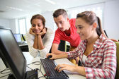 Group of students in computer's laboratory — Stock Photo