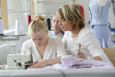 Student with teacher in dressmaking class — Stock Photo