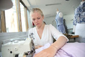 Young girl in sewing training course — Stock Photo