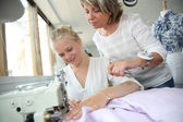 Student with teacher in dressmaking class — Stockfoto