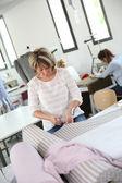 Dressmaker in training class — Stock Photo