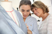 Student girl with teacher in training class — Stock Photo