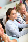 Student girl sitting in class — Stock Photo
