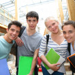 Cheerful students in school yard — Stock Photo