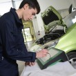 Stock Photo: Students doing car diagnostic
