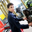 Student in mechanics working on car engine — Foto de Stock