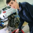 Student in mechanics working on car engine — Stock Photo