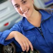 Постер, плакат: Student girl in auto mechanics