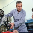 Trainer teaching student how to fix car engine — Stock Photo #35260163