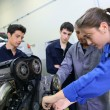 Постер, плакат: Mechanics training class with teacher and students