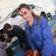 Постер, плакат: Woman in auto mechanics training class