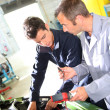 Trainer with student in repairshop — Stock Photo