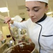 Student girl preparing melted chocolate — Stock Photo