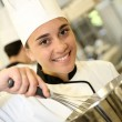 Student in pastry holding whip — Stock Photo #35260477