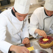Students making French pastry — Stock Photo