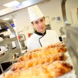 Stock Photo: Bakery student preparing viennese pastries