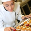 Stock Photo: Pastry cook holding tray of pastries