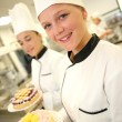Students girls in pastry holding cakes — Stock Photo #35260635