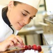 Girl at training school making cake — Stock Photo