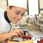 Girl at training school making cake — Stock Photo #35260677