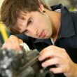 Teenager repairing bike engine — Stock Photo