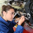Stock Photo: Student girl in motorbike mechanics