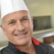 Smiling chef with uniform — Stock Photo