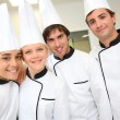 Restaurant chefs looking at camera — Stock Photo