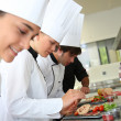 Stock Photo: Chefs preparing delicatessen dishes