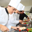 Chefs preparing delicatessen dishes — Stock Photo