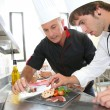 Student in catering to prepare foie gras dish — Stock Photo #35261201