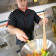Chef preparing wok of vegetables — Stock Photo