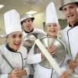 Cooks holding kitchenware — Stock Photo